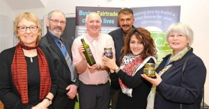Richard Dillon (with bottle of Zaytoun olive oil) with olive farmers and Keighley dignitaries