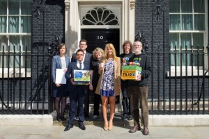 Karen Palframan (second on the right) and Cheska Hull (third on the right) join in the handover at Number 10. Credit: Matt Crossick (Fairtrade Foundation)