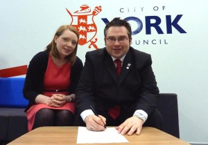 Councillor Linsay Cunningham-Cross and James Alexander, Leader of City of York Council, as he signs the Beyond 2015 declaration.
