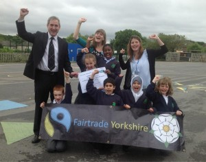 Fairtrade Yorkshire film winners woop for joy with Greg Mulholland MP, Hannah Langdana from Leeds DEC and teacher Jen Lansdown.