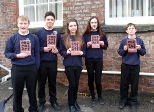Fulford School students with the book 'Chocolate Factory'.