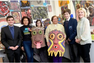 Tom (left) and Aimeth (third from right) with staff and students at Oasis Academy.
