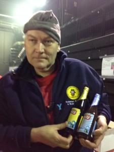 Ken Wyatt shows off Fairtrade beers.