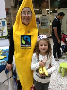 Fairtrade banana Joan Machin with young hat maker at the Merrion Centre