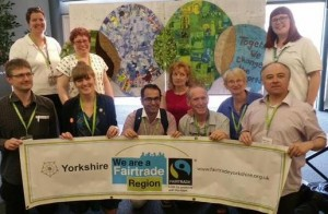 Yorkshire delegates in front of the conference logo display created by Holmfirth's 'Fair and Funky.'