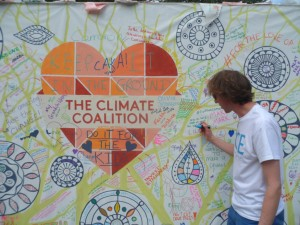 Richard Lane, Communications Officer of Fairtrade Yorkshire, adds his message to the display in Lambeth Palace Gardens.