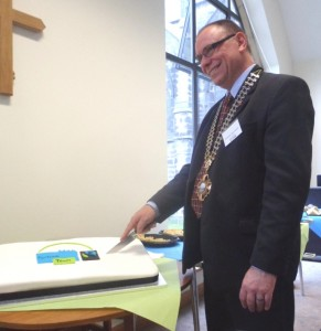 Chair of the Town Council, John Garvani cuts the cake