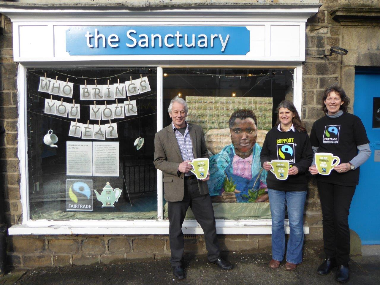 Ilkley Fairtrade group members & Ilkley Oxfam manager with the Sanctuary's Fairtrade tea window - hoping to give Malawian tea picker Mervis Kejinga a break. Artist Barbara Macnish.