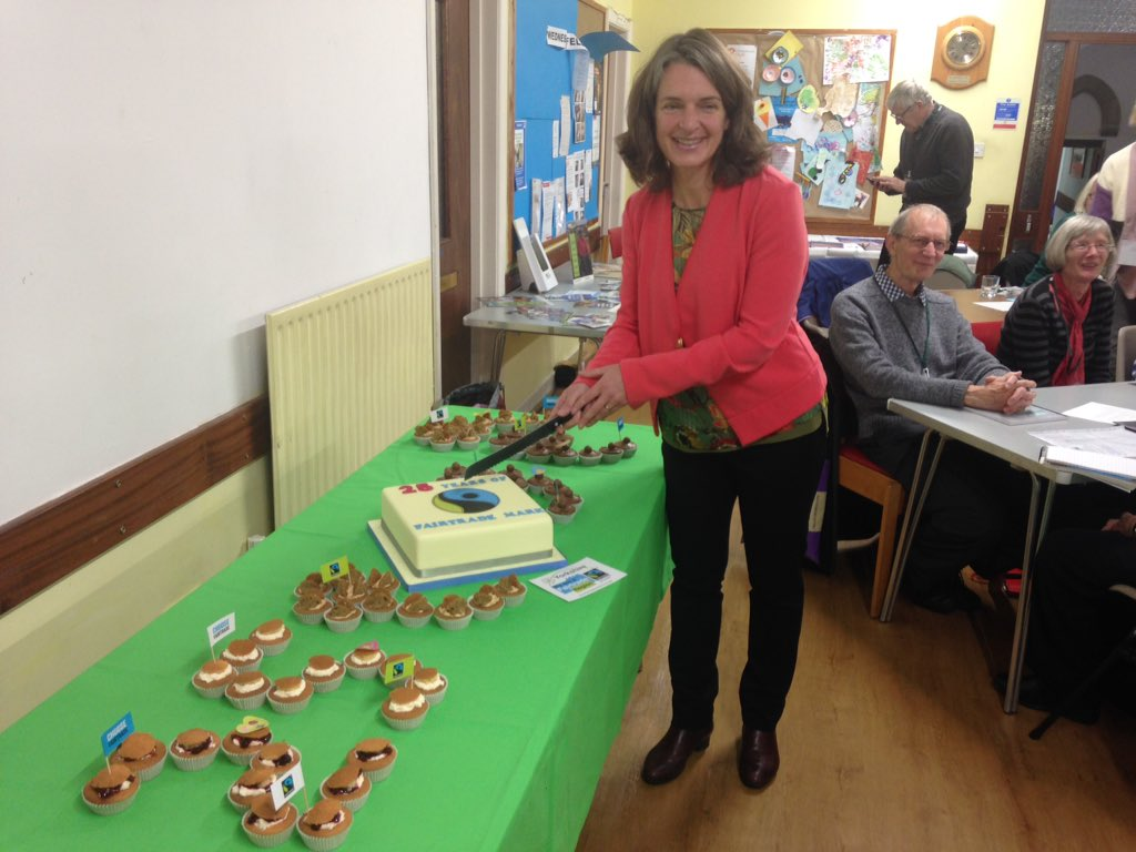 Cllr Ros Brown cutting the cake